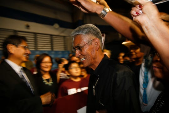 Navajo Nation Presidential candidate Joe Shirley Jr. walks with his supporters Tuesday at the Window Rock Sports Center in Window Rock, Ariz.