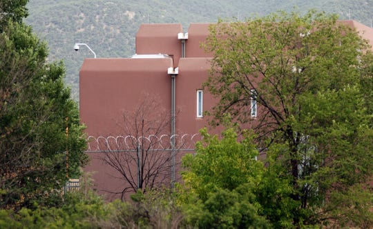 The Taos county jail, where three people accused of child abuse at a desert compound are awaiting release, is shown Aug. 15 in Taos.