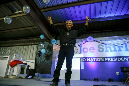 Navajo Nation Presidential candidate Joe Shirley Jr. waves to his supporters during his campaign party Tuesday at Nakai Hall on the Navajo Nation Fairgrounds in Window Rock, Ariz.