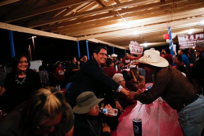 Jonathan Nez shakes hands with his supporters, Tuesday, Aug. 28, 2018 at his campaign party at the Navajo Nation Fair Grounds in Window Rock, Arizona.