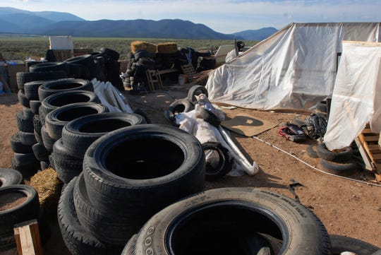 This Aug. 10 file photo shows part of a filthy desert compound where 11 children and a dead boy were found.