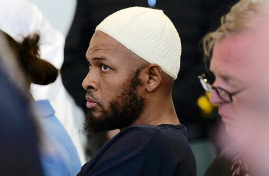 In this Monday, Aug. 13 file photo defendant Siraj Ibn Wahhaj sits in court in Taos, N.M., during a detention hearing.