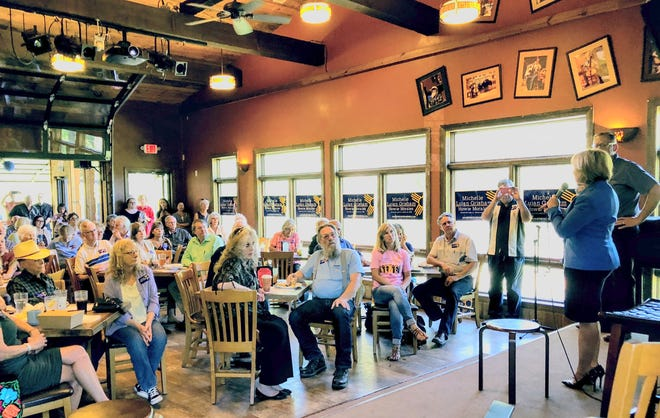 Michelle Lujan Grisham, Democrat candidate for governor, and Brian Colon, candidate for state auditor, were greeted by about 70 people at a Sacred Grounds get-together in Ruidoso Tuesday.