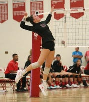 Churchill junior outside hitter Sarah Dunn goes up for the kill in Tuesday's three-set win over Canton.
