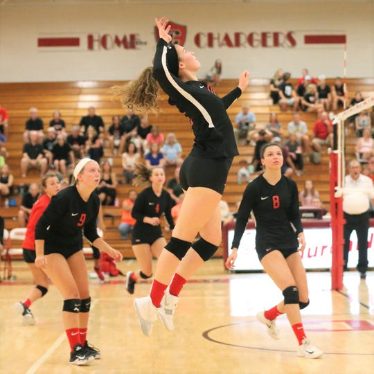 Canton's Maggie Adams rises up for the attack in Tuesday's match vs. Churchill.