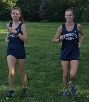Mary Jarvis (left) and Abby Inch are experienced runners for veteran Farmington head coach Chip Bridges
