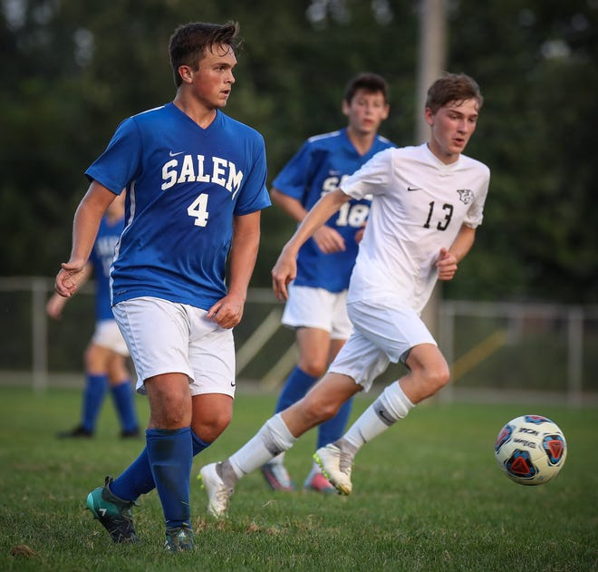 Going stride for stride Tuesday night are Salem's Hudson Shields (4) and Plymouth's Caleb Crawford.