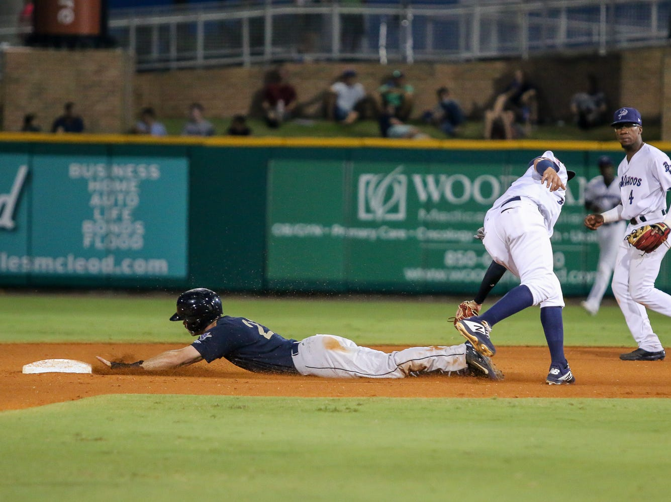 Pensacola shortstop Luis Gonzalez (19) can't get the throw from catcher Chris Oakey down in time to keep Mobile's Brandon Sandoval (21) from stealing second base during the Blue Wahoos' last home game of the regular season on Tuesday, August 28, 2018.