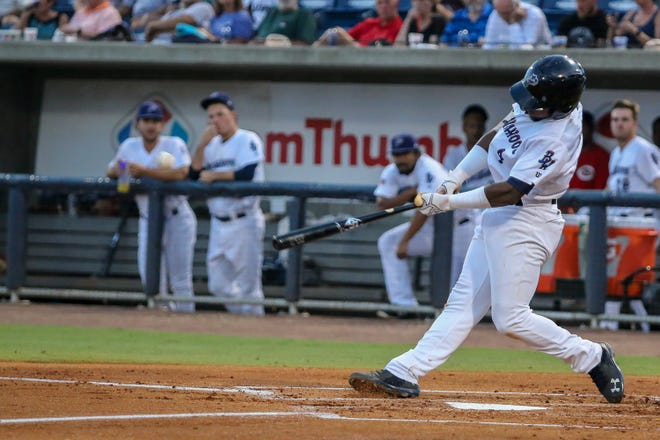 The Blue Wahoos' Shed Long, shown in earlier game, smashed a two-run homer Sunday in team's 4-3 win against the Tennessee Smokies that clinched a playoff spot.