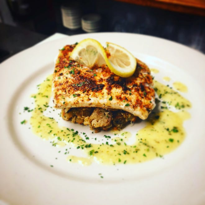 Chef Coleman Jernigan's blackened Red Snapper over shrimp stuffing drizzled with a Buerre Blanc sauce.