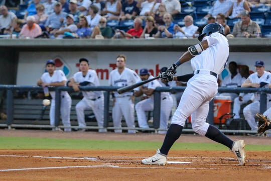 Pensacola's Narciso Crook (8) hits a pitch thrown by Mobile's Patrick Sandoval during the Blue Wahoos' last home game of the regular season on Tuesday, August 28, 2018.