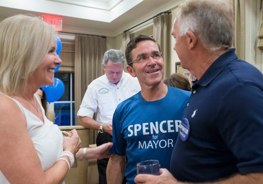 Mayoral candidate Brian Spencer, center, greets supporters Lauren Hayward and Robby Boothe during a gathering at Lee House in Pensacola on Tuesday, August 28, 2018.