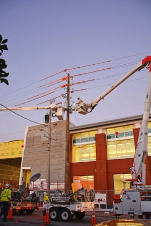 Gulf Power crews work on upgrades to the downtown Pensacola distribution system.