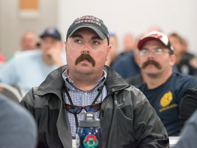 Jonathon Lyles, of the Mobile Fire-Rescue Department,  listens along with fellow firefighters from across the country during the Water On The Fire firefighters conference at the Hilton hotel in Pensacola Beach on Wednesday, August 29, 2018.
