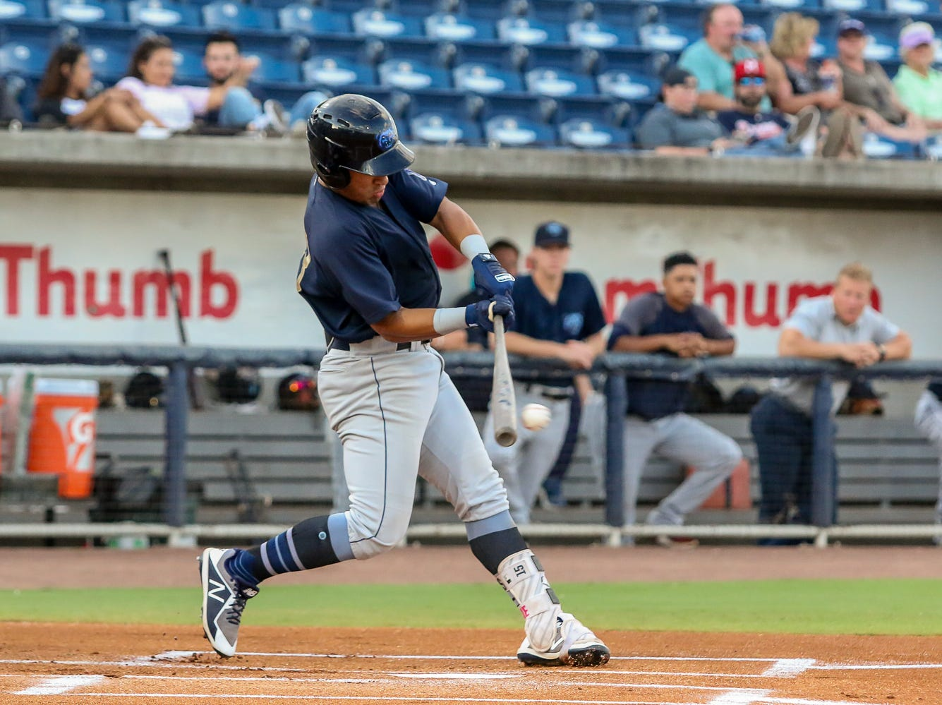 Mobile's Jahmai Jones (23) hits the ball to Pensacola shortstop Luis Gonzalez and is thrown out at first base during the Blue Wahoos' last home game of the regular season on Tuesday, August 28, 2018.