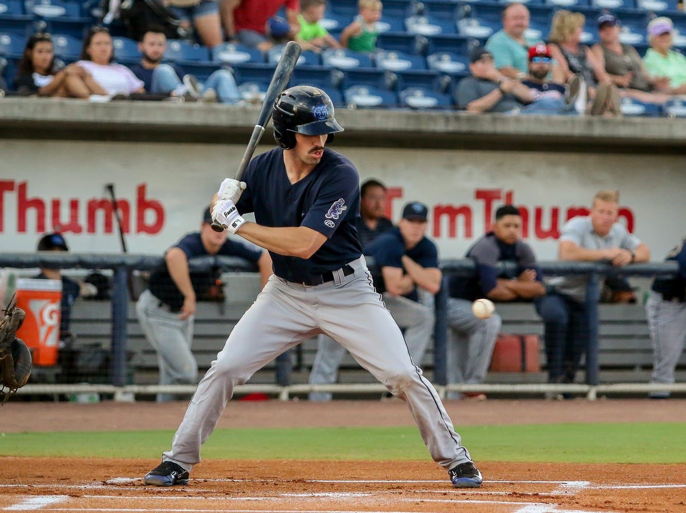 Mobile's Brandon Sandoval (21) gets caught looking as a strike thrown by Pensacola pitcher Wyatt Strahan flies by him during the Blue Wahoos' last home game of the regular season on Tuesday, August 28, 2018.