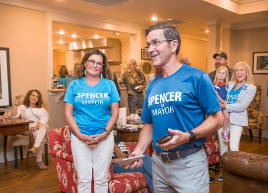 Crystal Spencer, left, listens as her husband and mayoral candidate Brian Spencer thanks supporters during a gathering at Lee House in Pensacola on Tuesday, August 28, 2018.  Spencer came in second place and will face off with Grover Robinson in November's general election.