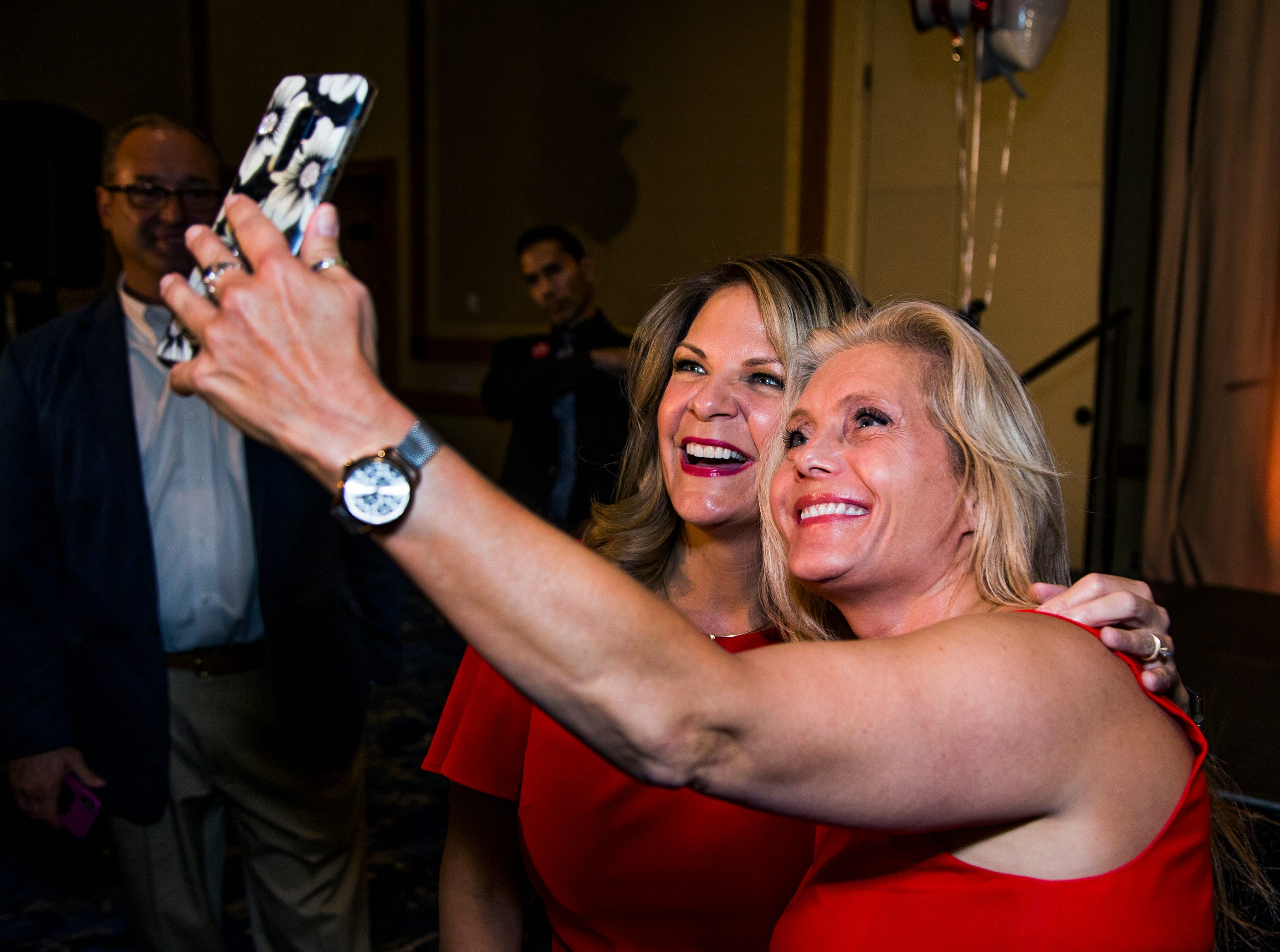 Kelli Ward (left) takes a selfie with supporter Suzette Meyers during a primary election night party at Embassy Suites Scottsdale, Aug. 28, 2018.