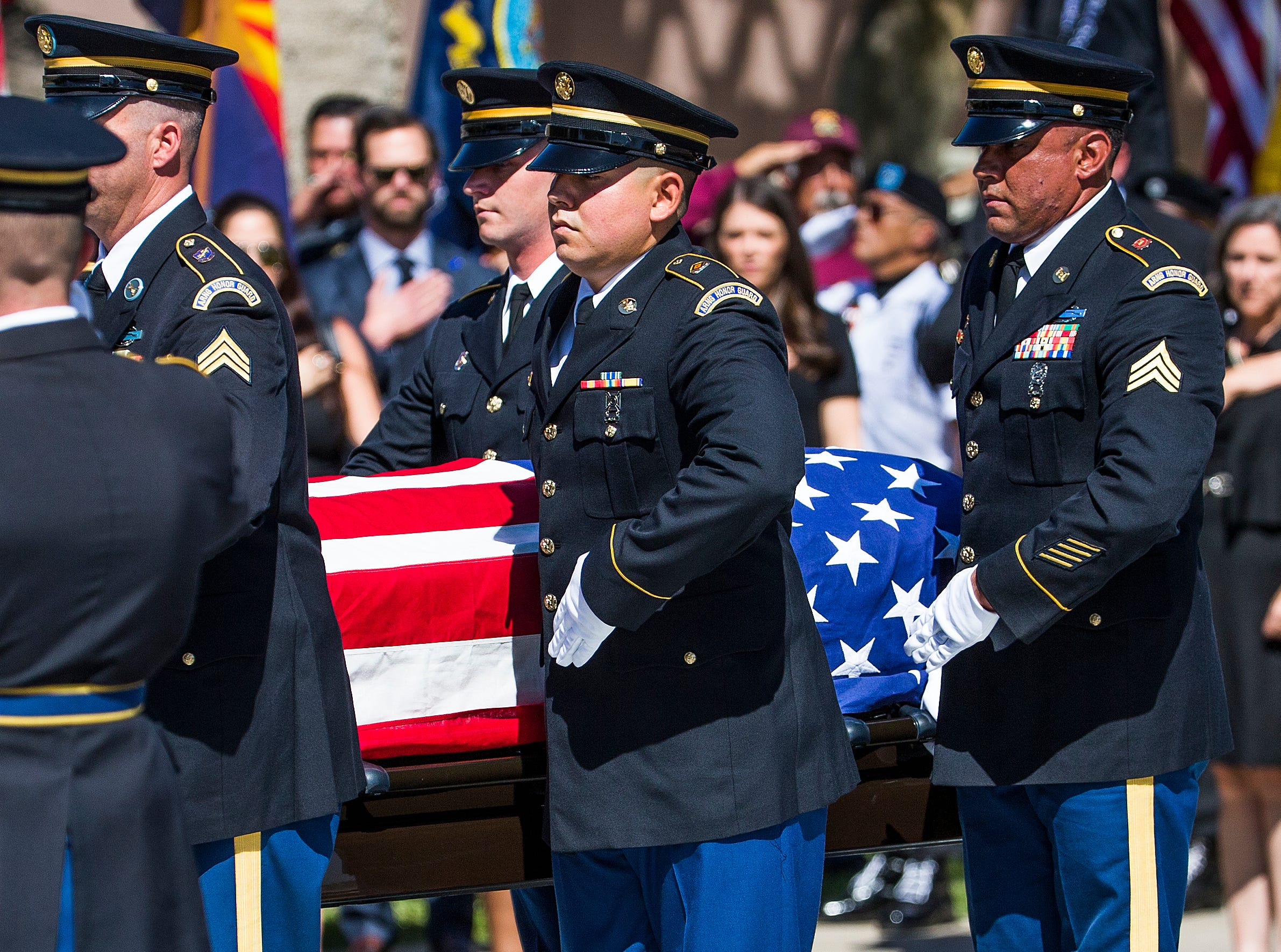 The casket is taken from the hearse with the body of Sen. John McCain after arriving at the Capitol in Phoenix Wednesday morning, August 29, 2018, for a memorial service. McCain's body will lie in state in the rotunda for the public to pay their final respects.