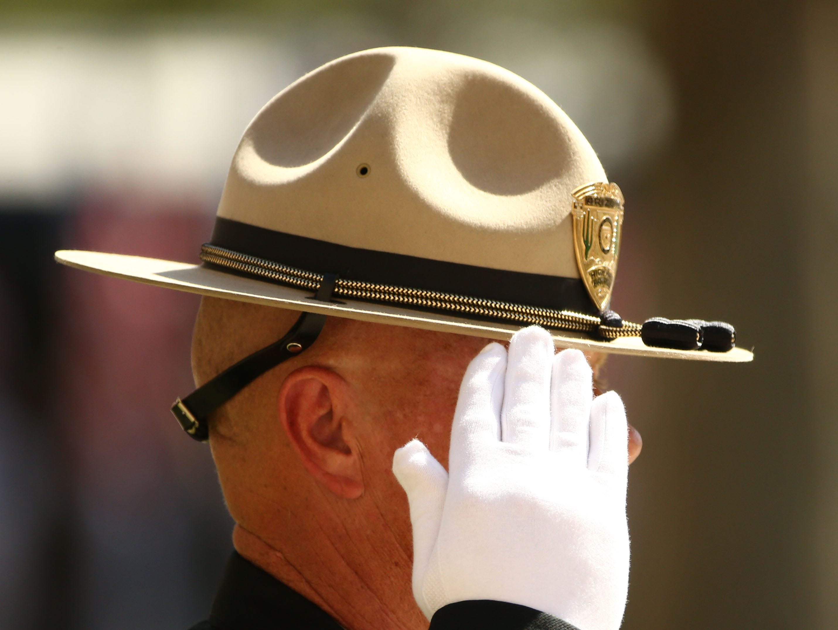 DPS officers line the plaza as the casket of U.S. Sen. John McCain arrives for his memorial service at the Arizona State Capitol on Aug. 29, 2018, in Phoenix, Ariz.