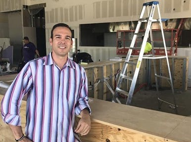 Mike Merendino at Crust Pizzeria in Scottsdale during construction.