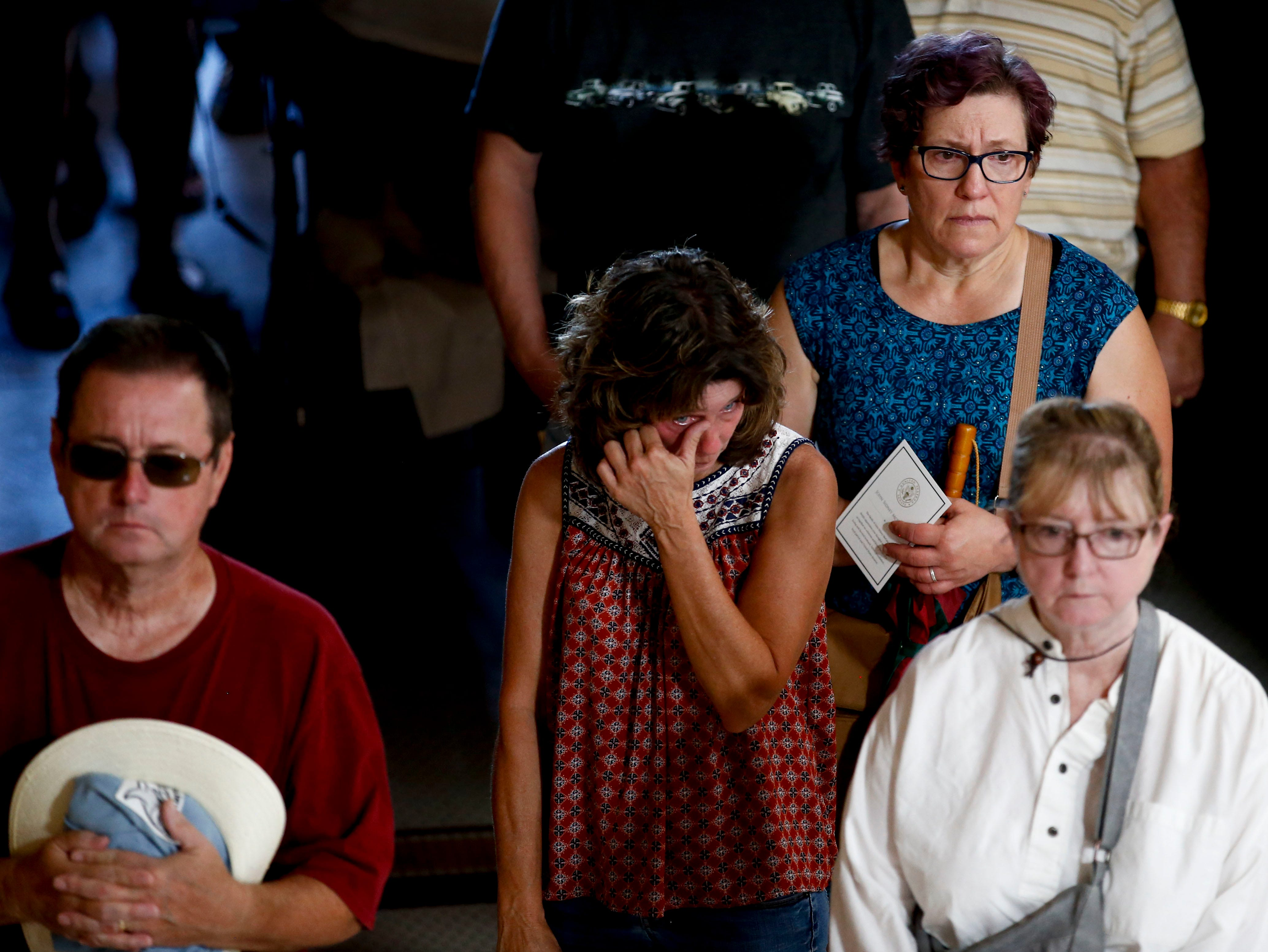 Members of the public line up to pay their respects for Sen. John McCain during a viewing at the Arizona Capitol on Wednesday, Aug. 29, 2018, in Phoenix. (AP Photo/Ross D. Franklin)