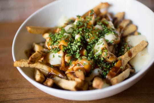 Poutine, a hearty dish of fries, cheese curds and gravy, is as Canadian as hockey and maple syrup.