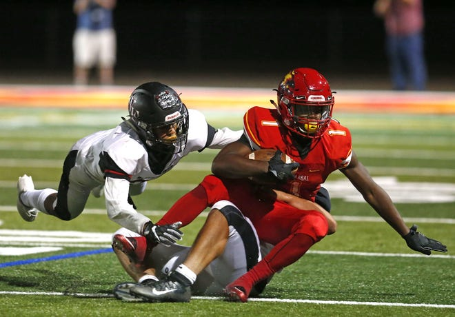 Williams Field's Sam Hancock (42) takes down Chaparral's Marqui Johnson (1) during a high school football game at Chaparral in Scottsdale on September 15, 2017.