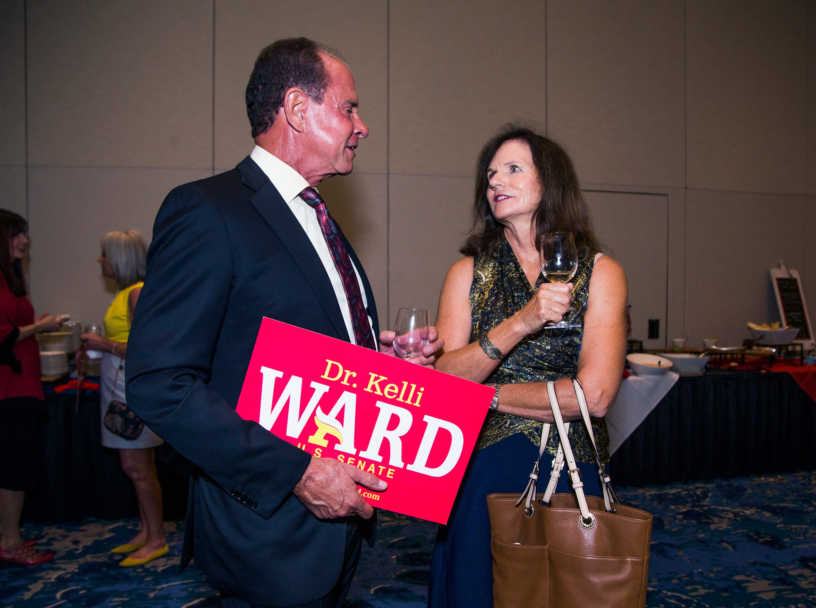 Jim and Kathleen Clark of Phoenix, supporters of Kelli Ward, wait for her appearance at a primary election night party at Embassy Suites Scottsdale, Aug. 28, 2018.