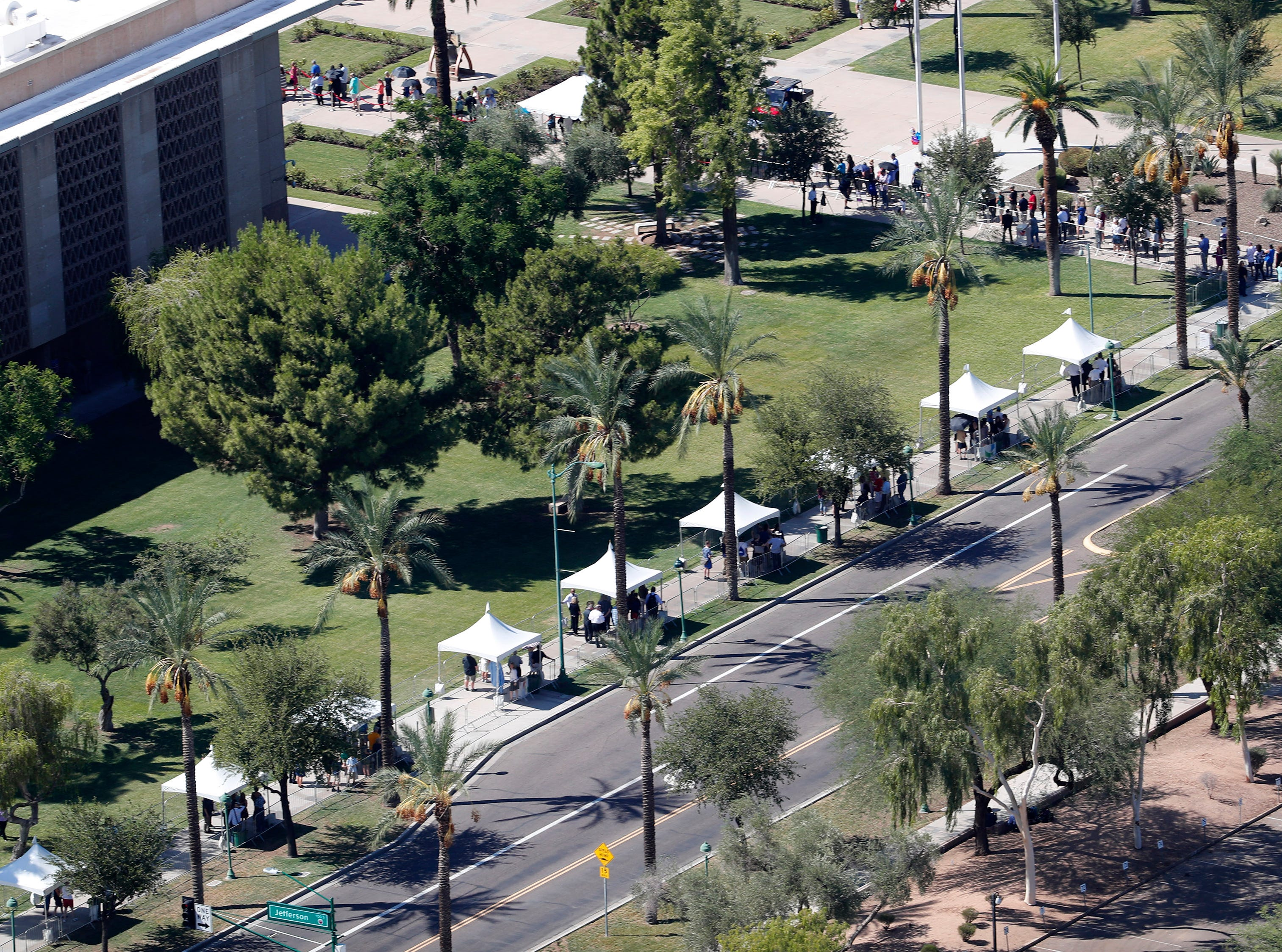 People line up outside the Arizona state Capitol, where Sen. John McCain lies in state in Phoenix Aug. 29. 2018. The six-term Arizona senator died Saturday after a 13-month battle with brain cancer.