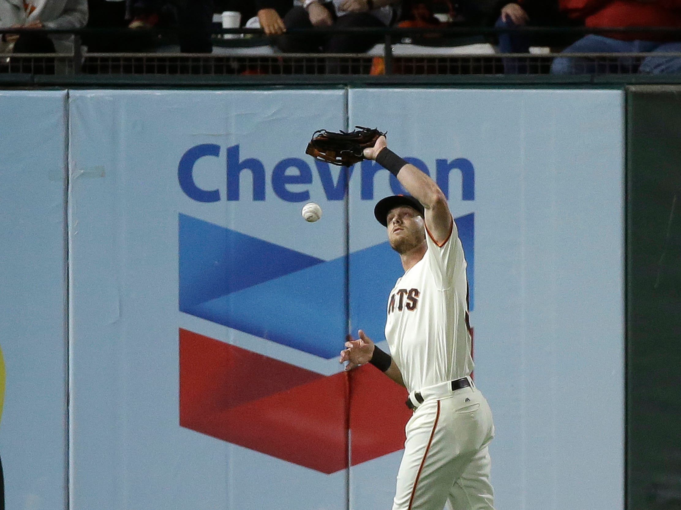 San Francisco Giants left fielder Austin Slater drops a fly ball hit by the Arizona Diamondbacks' Jon Jay in the seventh inning of a baseball game, Tuesday, Aug. 28, 2018, in San Francisco. Slater was given an error and Jay was safe at third base on the play.
