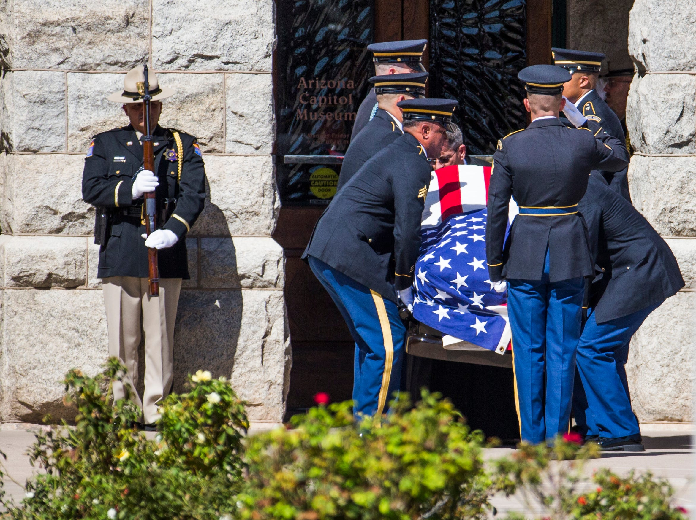 The casket is taken into the Capitol rotunda with the body of Sen. John McCain in Phoenix Wednesday morning, August 29, 2018, After a memorial service, the public will be able to give their final respects.