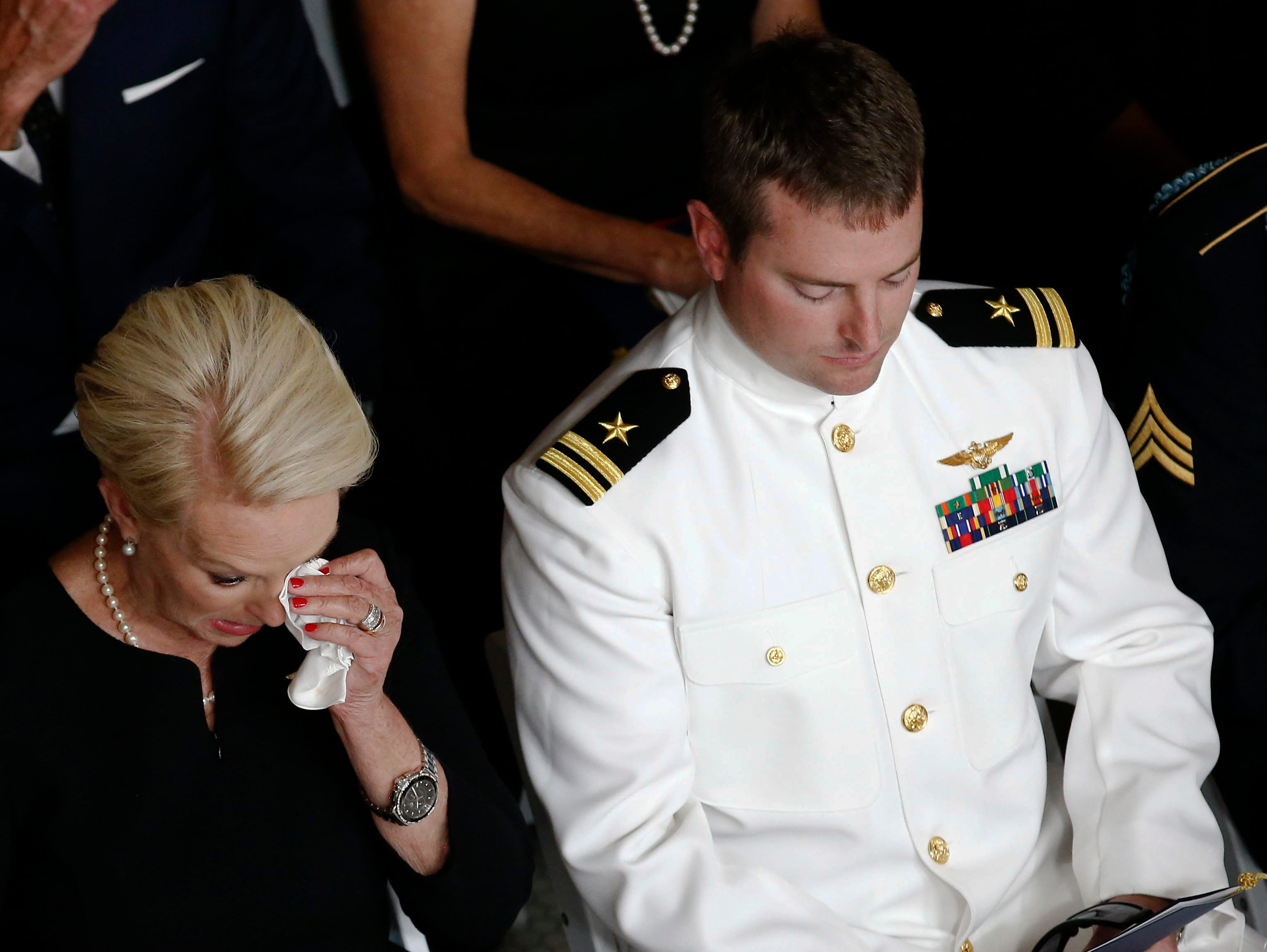 Cindy McCain, wife of Sen. John McCain, R-Ariz., wipes a tear away next to her son Jack during a memorial service at the Arizona Capitol on Aug. 29, 2018, in Phoenix.