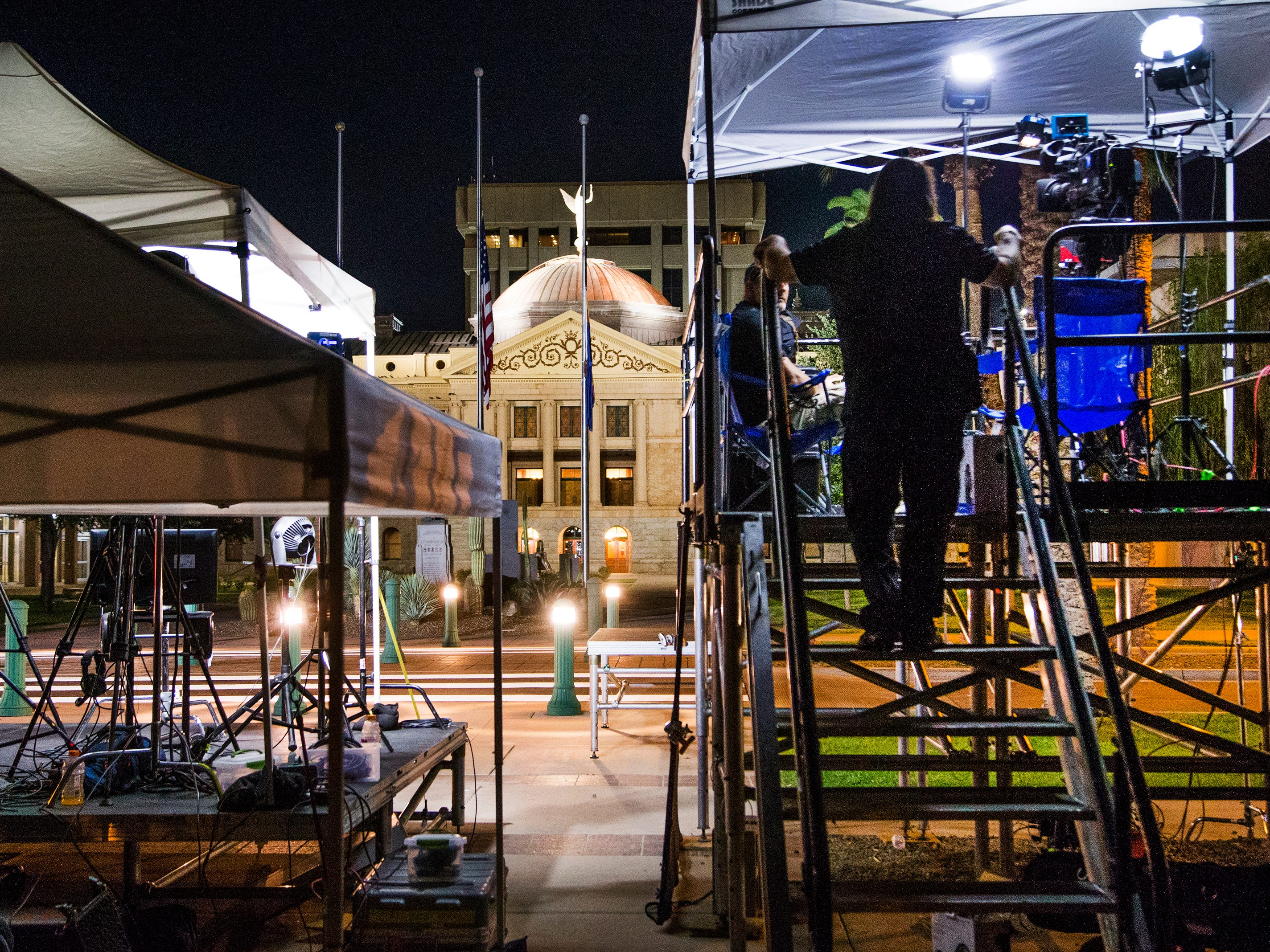 Media from around the world focus on the Capitol in Phoenix at 5 a.m., Aug. 29, 2018. The body of Sen. John McCain will lie in state later in the morning in the rotunda.