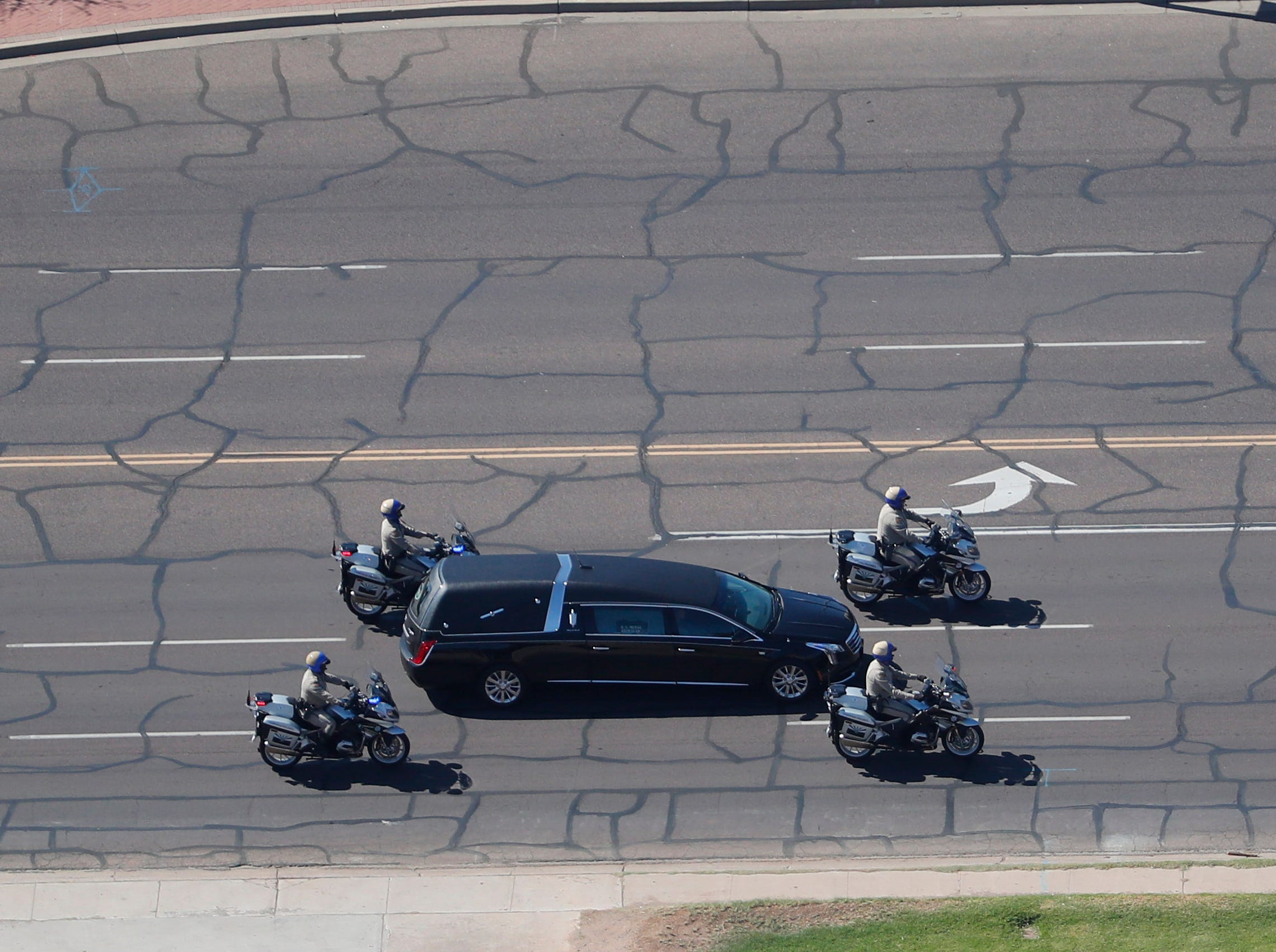 Sen. John McCain's motorcade makes its way to the Arizona State Capitol in Phoenix, Ariz. where the senator will lie in state August 29. 2018. The six-term Arizona senator died Saturday after a 13-month battle with brain cancer.