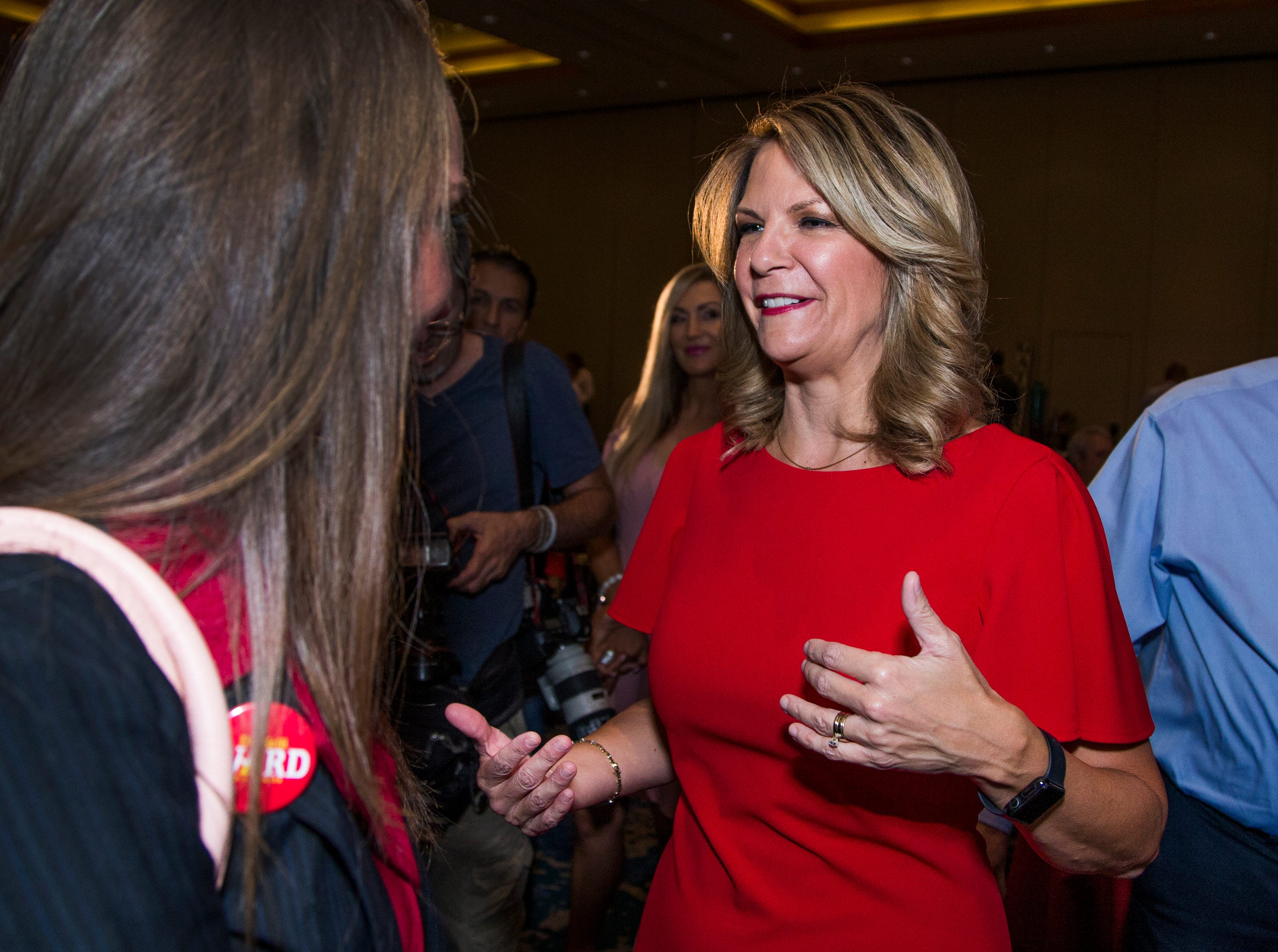 Kelli Ward (right) greets supporter Courtney Kinneard, 23, of Mesa, during a primary election night party at Embassy Suites Scottsdale, Aug. 28, 2018.