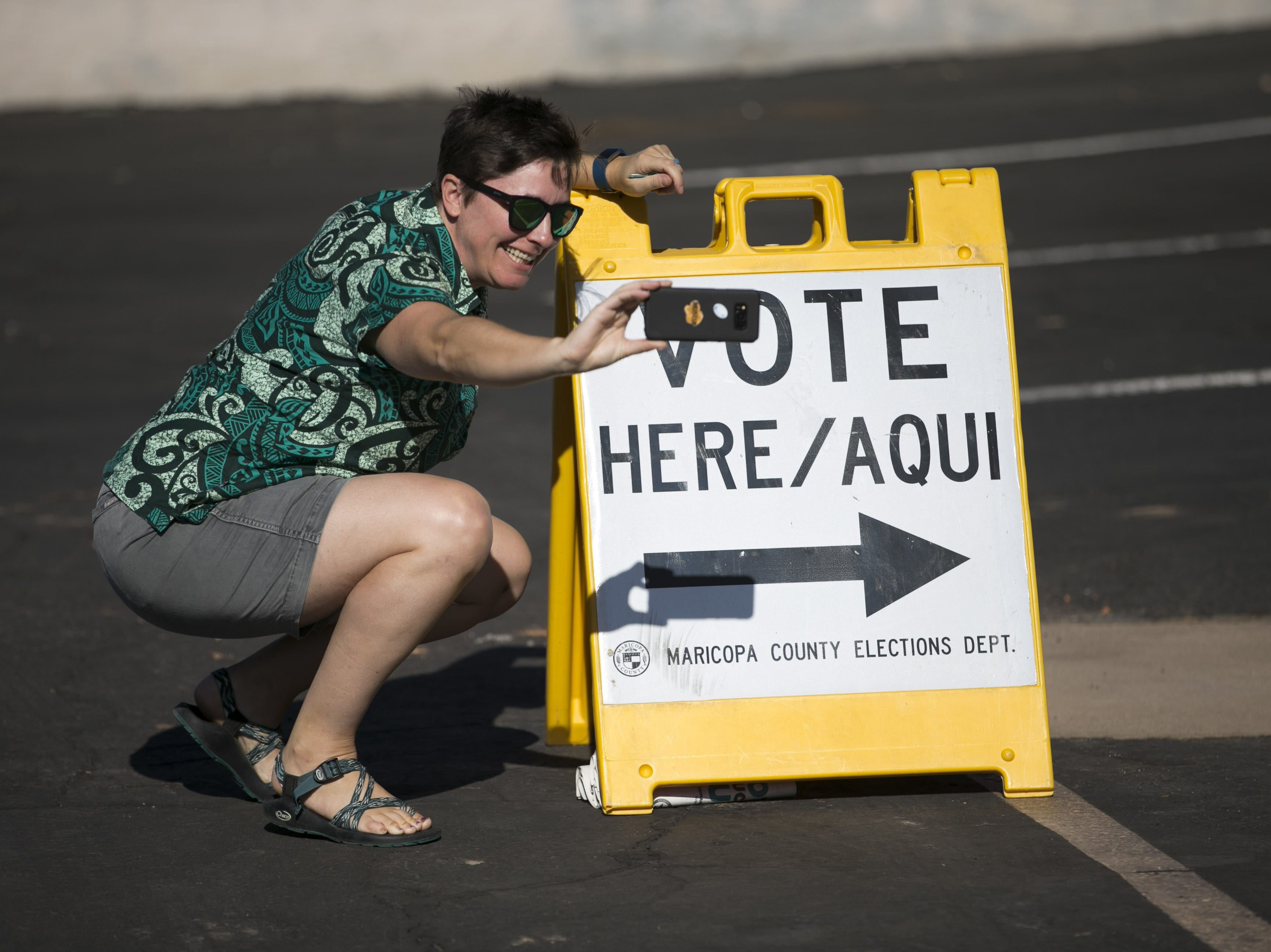 Katie Hinde of Phoenix takes a selfie after voting in the primary at the polling place at Memorial Presbyterian Church in Phoenix on Aug. 28, 2018.