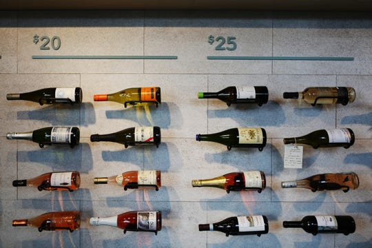 Bottles in categories of $20 and $25 are displayed inside the Sauvage Bottle Shop in the Churchill in downtown Phoenix.