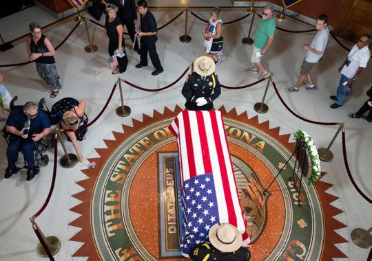The public pays their respects to Senator John McCain as he lies in state in the Rotunda at the state capital on August 29, 2018.