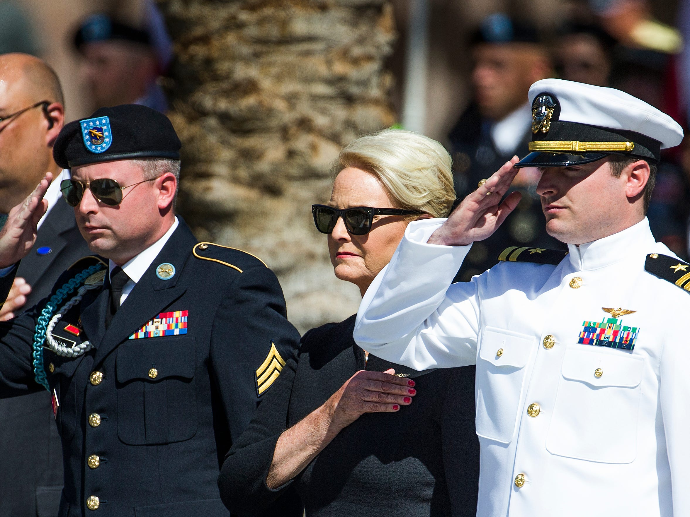 Cindy McCain and her family, along with Gov. Doug Ducey and his wife, salute as the casket of Sen. John McCain is taken from the hearse at the Capitol in Phoenix Wednesday morning, August 29, 2018. A memorial service for Sen. John McCain will be held and McCain's body will lie in state in the rotunda for the public to pay their final respects.