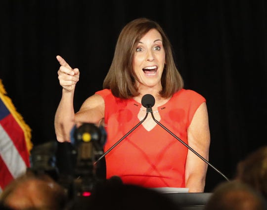 Rep. Martha McSally greets supporters during a primary election party Aug. 28 In Tempe. In the general election, McSally will need to gather support from moderate Republicans and independents.