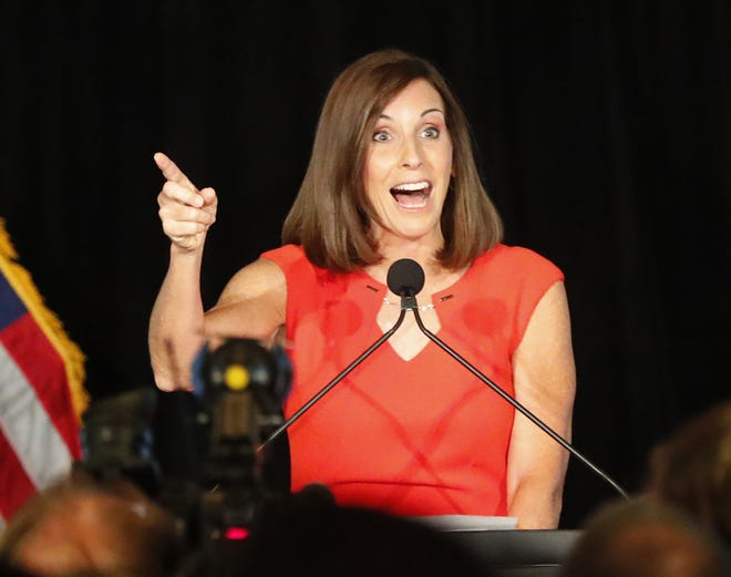 Rep. Martha McSally greets supporters during a primary election party Aug. 28 In Tempe. In the general election, McSally will need to gather support frommoderate Republicans and independents.