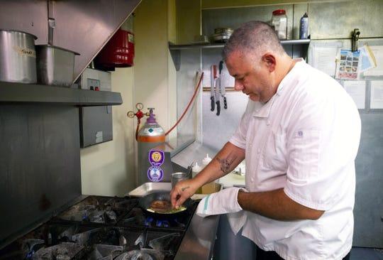 Steven Maynard, chef owner of Tempo Urban Bistro, prepares a center cut sirloin at his Buckeye restaurant on August 23, 2018.