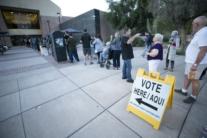 People wait in line to vote in the primary at the polling place at the Tempe Public Library on Tuesday evening, Aug. 28, 2018.