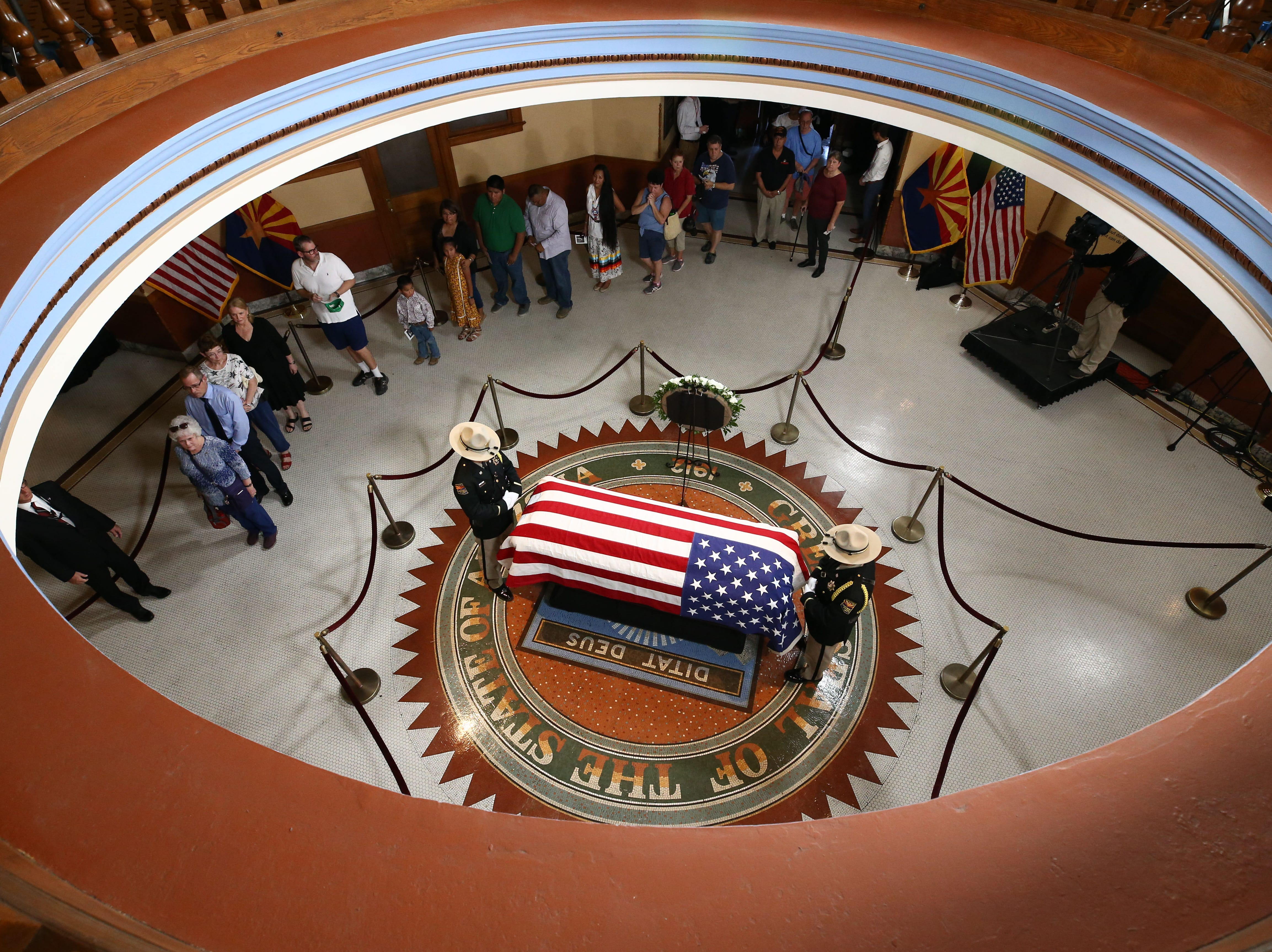 The public pays their respects to Senator John McCain as he lies in state in the Rotunda with an Arizona National Guard of Honor in attendance following his memorial service at the Arizona State Capitol on Aug. 29, 2018, in Phoenix, Ariz.