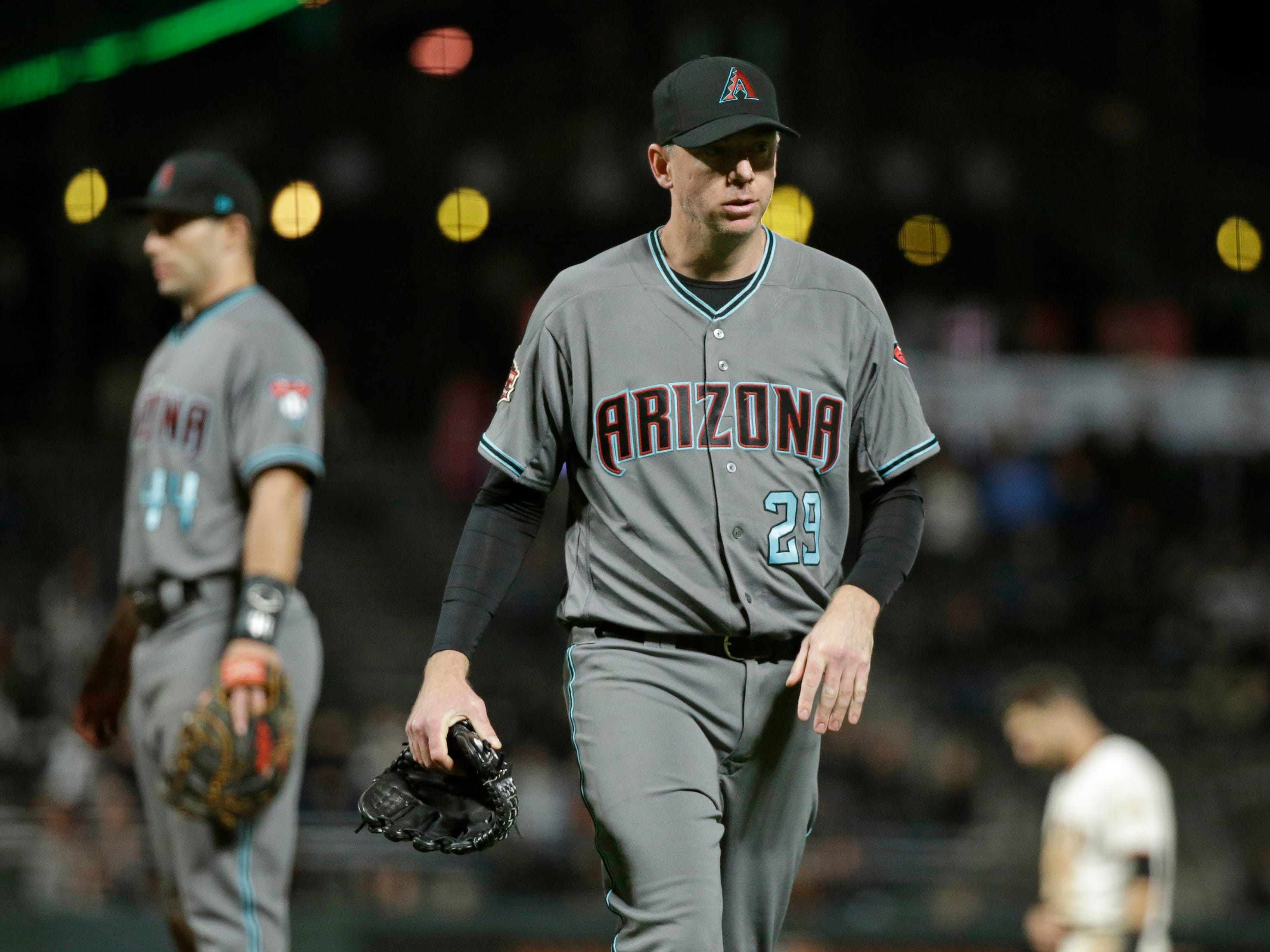 Arizona Diamondbacks relief pitcher Brad Ziegler walks to the dugout after being removed in the ninth inning of a baseball game against the San Francisco Giants, Tuesday, Aug. 28, 2018, in San Francisco. San Francisco won the game 1-0 and Ziegler was the losing pitcher.