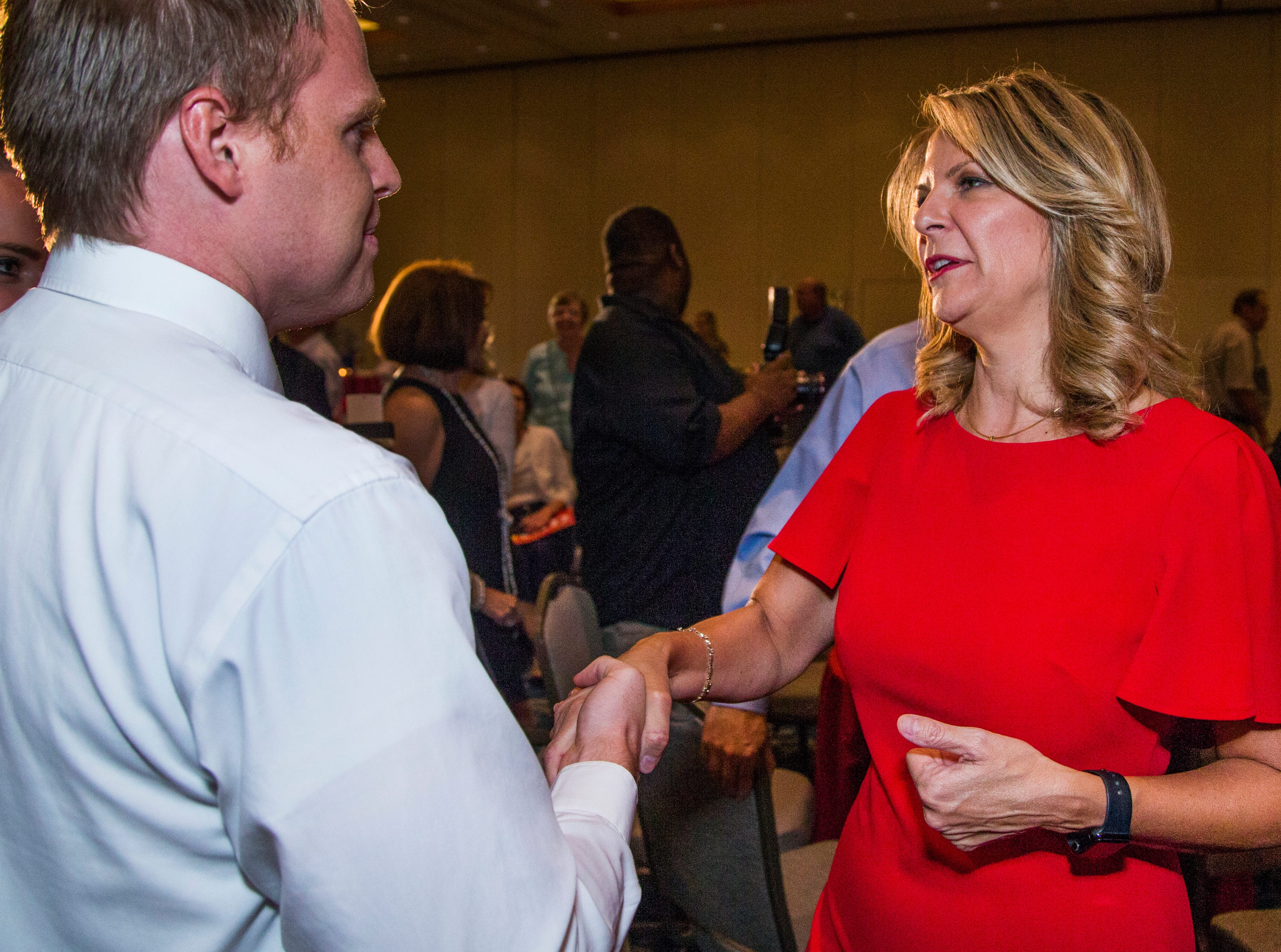 Kelli Ward (right) greets supporter Carter Brown, 25, of Mesa, during a primary election night party at Embassy Suites Scottsdale on Aug. 28, 2018.