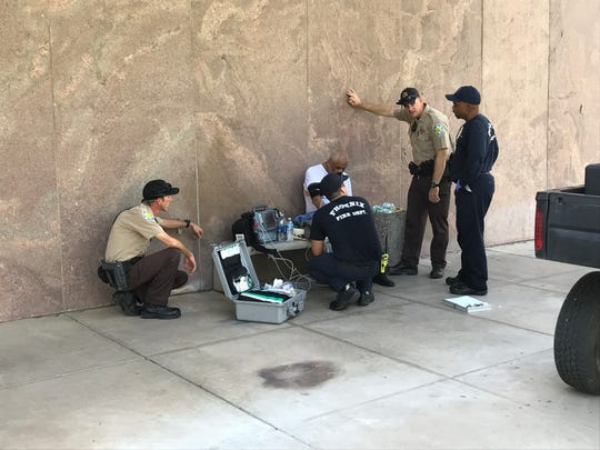Phoenix fire personnel treat a man waiting in line to pay his respects to the late Sen. John McCain at the Arizona state Capitol in Phoenix on Aug. 29, 2018.