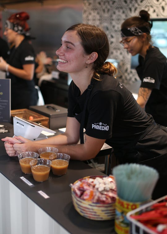 Staff greet customers at the counter of Provecho at the Churchill in downtown Phoenix.