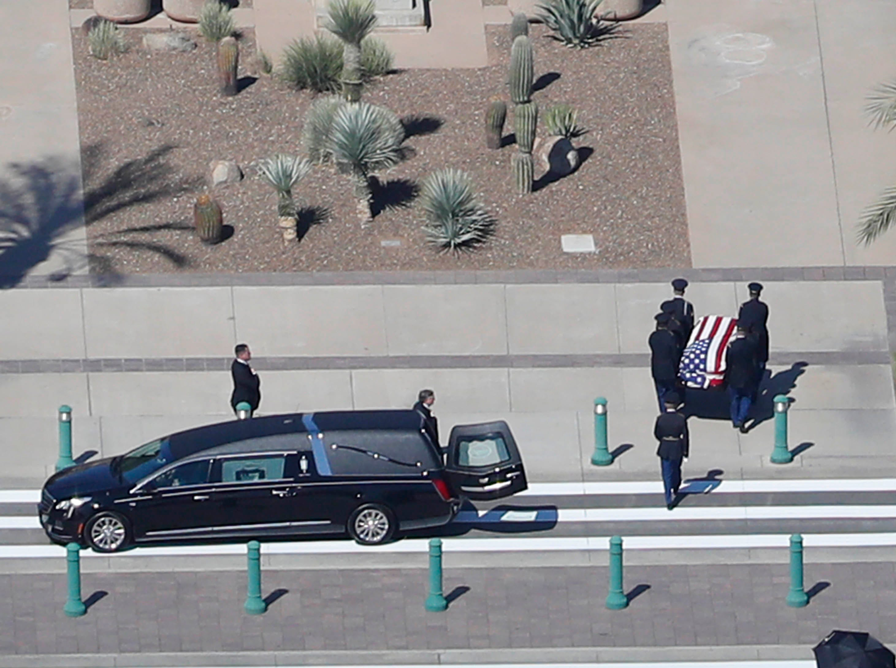 The Arizona National Guard escorts Sen. John McCain's casket to the Arizona State Capitol Rotunda in Phoenix, Ariz. where he will lie in state August 29. 2018. The six-term Arizona senator died Saturday after a 13-month battle with brain cancer.